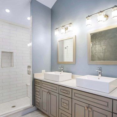 vessel sinks and shower installed by bathroom remodeling contractor