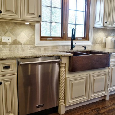 traditional cabinets and copper sink installed by kitchen remodeling contractor