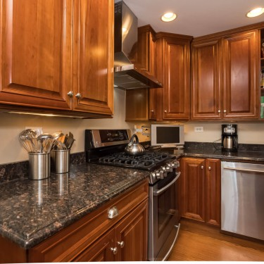 cherry cabinets and black granite installed by kitchen remodeling contractor
