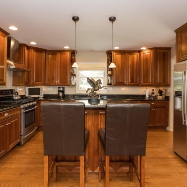 cherry wood cabinets installed by kitchen remodeling contractor