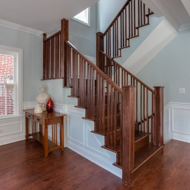 custom staircase built by home addition contractor
