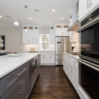 double oven and gray island by home addition contractor