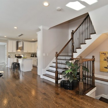 custom built staircase leads to new level by home addition contractor