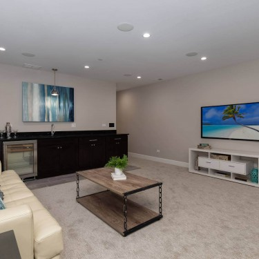 family room and wetbar by basement finishing remodeling contractor