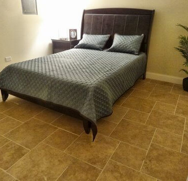 bedroom and tile by basement finishing remodeling contractor