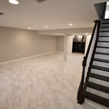vinyl flooring and staircase by basement finishing remodeling contractor