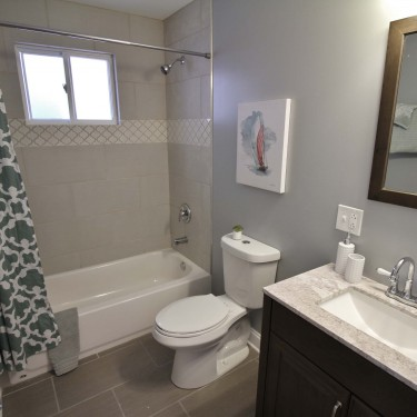 dark gray and light gray 12 by 24 tiles installed by bathroom remodeling contractor