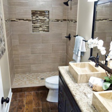 double bowl vanity with travertine vessels installed by bathroom remodeling contractor
