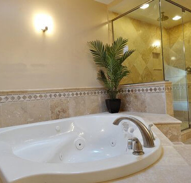 jacuzzi tub and travertine shower installed by bathroom remodeling contractor