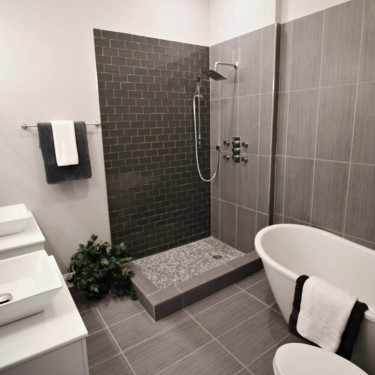 modern black tiles installed by bathroom remodeling contractor