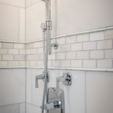 close up of shower wand by bathroom remodeling contractor