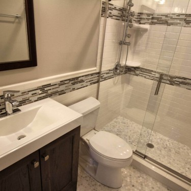 pull down bench installed in shower of bathroom remodeling contractor