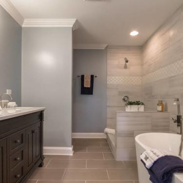 bathroom remodeling contractor installs dark vanity