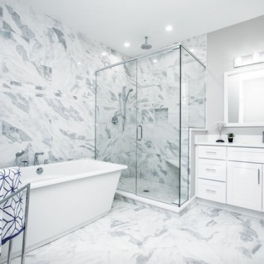 floor to ceiling marble tile installed by bathroom remodeling contractor