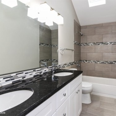 gray modern tiles installed by bathroom remodeling contractor