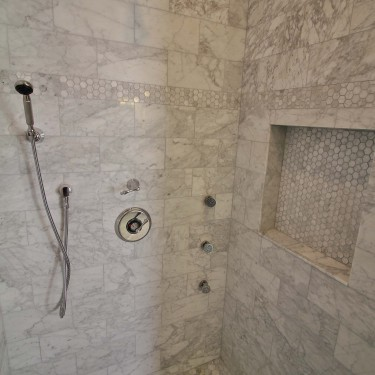 marble shower and vertical spa installed by bathroom remodeling contractor