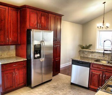Red cabinets installed by kitchen remodeling contractor