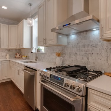 white marble backsplash white and gray shaker cabinets by kitchen remodeling contractor