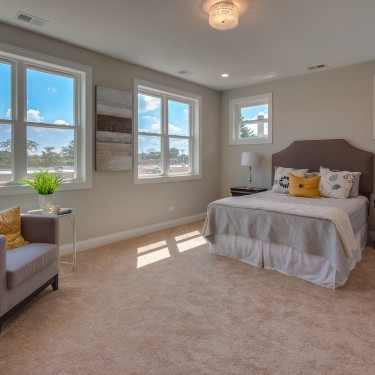 master bedroom in new construction home by custom home builder