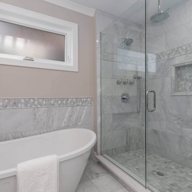 new construction custom home builder installs shower and freestanding tub in master bath