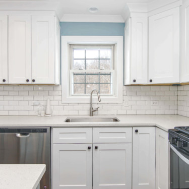 kitchen remodeling contractor paints walls nimbus gray and uses shaker cabinetry