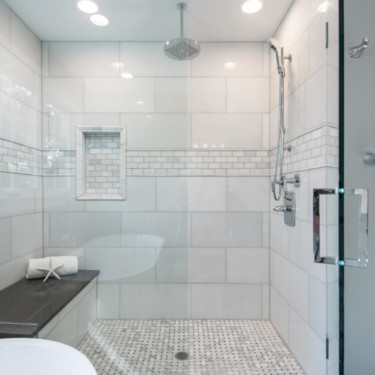 bathroom remodeling contractor installs marble tile and rainfall showerhead